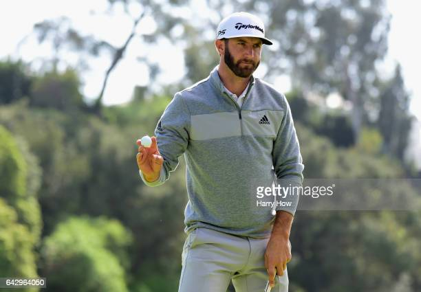 Dustin Johnson reacts to his par save on the eighth hole during the final round at the Genesis Open at Riviera Country Club on February 19 2017 in...