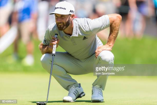 Dustin Johnson reads the green in advance of his put on the 9th hole during final round action of the RBC Canadian Open on July 30 at Glen Abbey Golf...