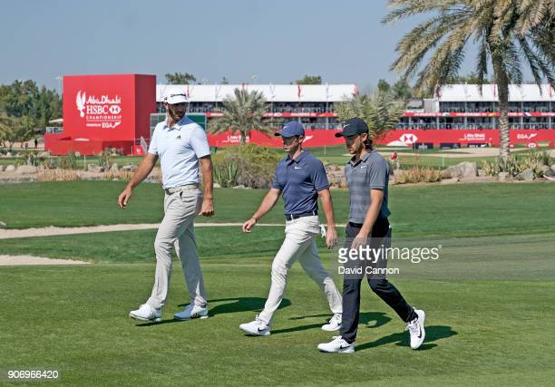 Dustin Johnson Rory McIlroy and Tommy Fleetwood walk down the first fairway during the second round of the 2018 Abu Dhabi HSBC Gof Championship at...