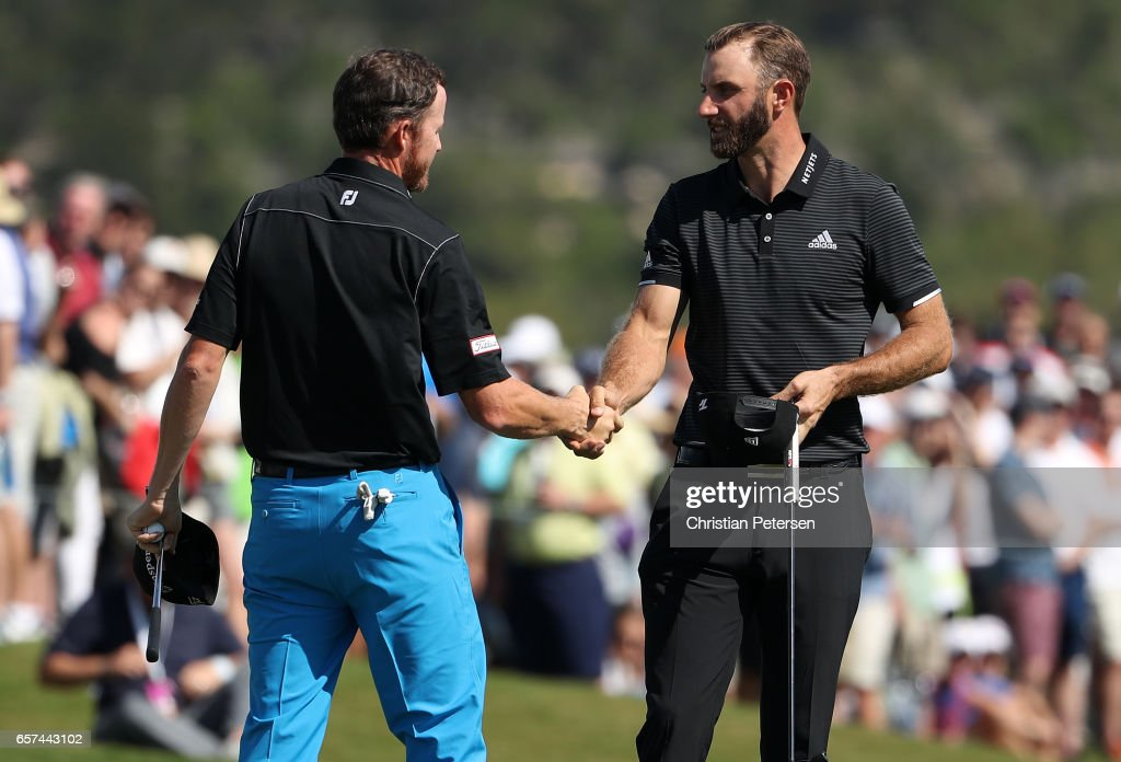 Dustin Johnson (R) shakes hands with Jimmy Walker after winning their match 5&3 on the 15th hole during round three of the World Golf Championships-Dell Technologies Match Play at the Austin Country Club on March 24, 2017 in Austin, Texas.