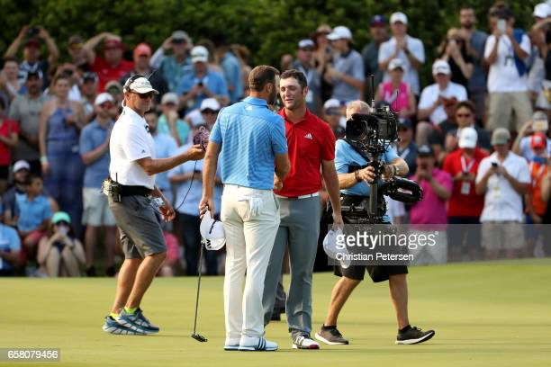 Dustin Johnson shakes hands with Jon Rahm of Spain after winning the World Golf Championships-Dell Technologies Match Play at the Austin Country Club...