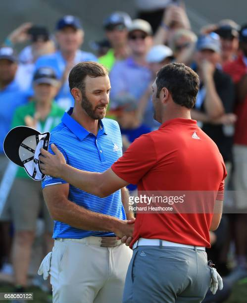 Dustin Johnson shakes hands with Jon Rahm of Spain after winning the final match of the World Golf Championships-Dell Technologies Match Play 1 up on...