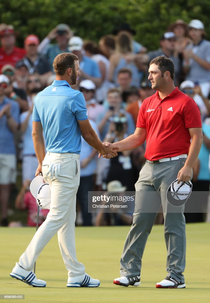 Dustin Johnson (L) shakes hands with Jon Rahm of Spain after winning the World Golf Championships-Dell Technologies Match Play at the Austin Country Club on March 26, 2017 in Austin, Texas.
