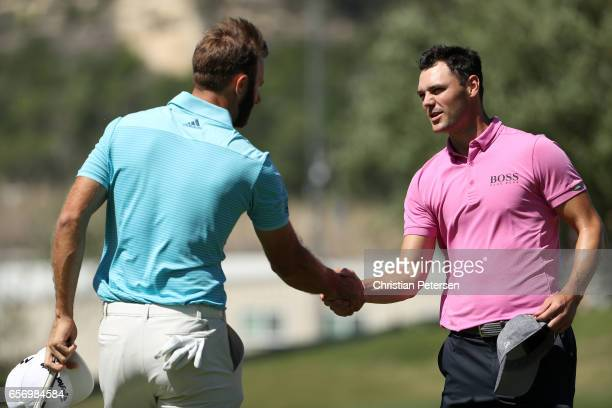 Dustin Johnson shakes hands with Martin Kaymer of Germany after winning his match during round two of the World Golf ChampionshipsDell Technologies...