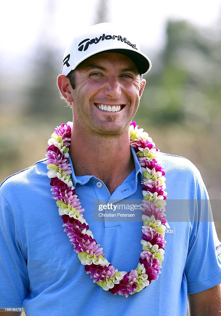 Dustin Johnson smiles after winning the Hyundai Tournament of Champions following the final round at the Plantation Course on January 8, 2013 in Kapalua, Hawaii.
