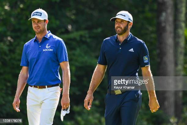 Dustin Johnson smiles as he speaks with Harris English on the fifth hole during the final round of THE NORTHERN TRUST at TPC Boston on August 23,...