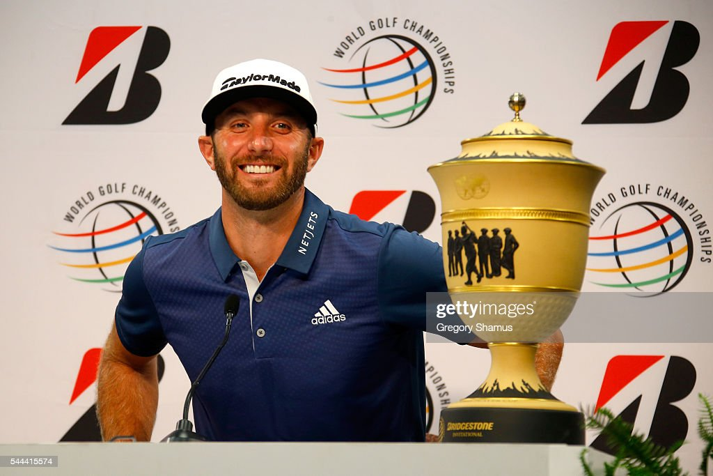 Dustin Johnson speaks to the media with the Gary Player Cup after winning the World Golf Championships - Bridgestone Invitational during the final round at Firestone Country Club South Course on July 3, 2016 in Akron, Ohio. Johnson finished with a score of -6.