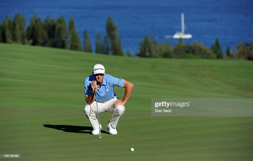 Dustin Johnson studies his putt on the fourth green during the final round of the Hyundai Tournament of Champions at Plantation Course at Kapalua on January 8, 2013 in Kapalua, Maui, Hawaii.
