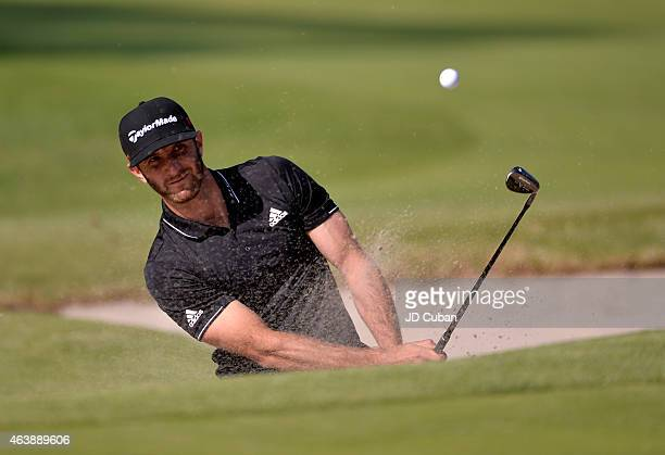 Dustin Johnson takes his second shot on the 10th hole during round one of the Northern Trust Open at Riviera Country Club on February 19 2015 in...