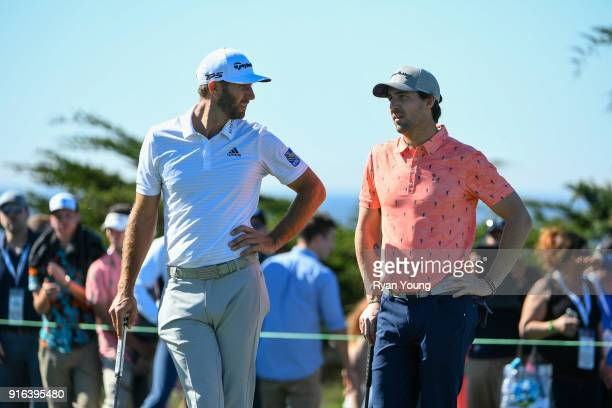 Dustin Johnson talks with Jake Owen during the second round of the ATT Pebble Beach ProAm at Pebble Beach Golf Links on February 9 2018 in Pebble...