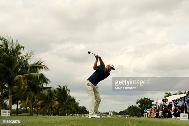 Dustin Johnson tees off on the second hole during the third round of the World Golf Championships-Cadillac Championship at Trump National Doral Blue...