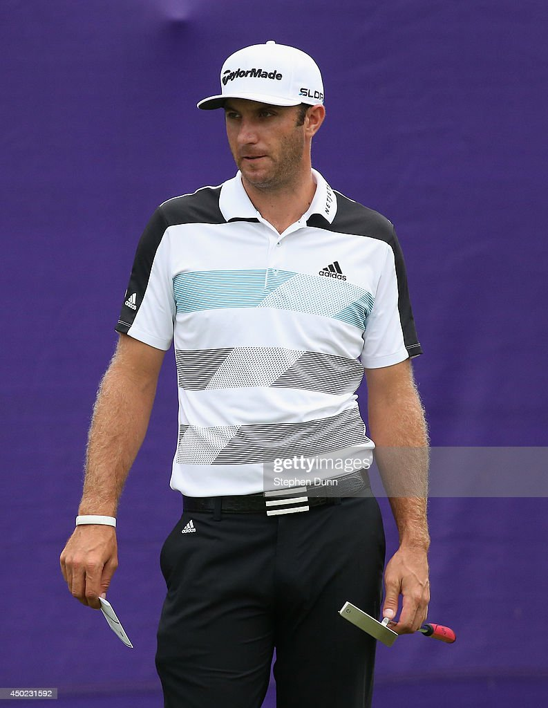 Dustin Johnson waits to tee off on the first hole to start his round during the continuation of the second round of the FedEx St. Jude Classic at the TPC Southwind on June 7, 2014 in Memphis, Tennessee.