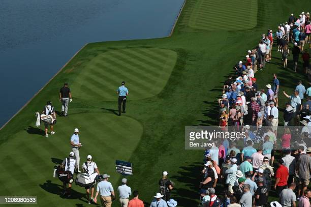 Dustin Johnson walks from the 18th tee during the first round of THE PLAYERS Championship on THE PLAYERS Stadium Course at TPC Sawgrass on March 12...