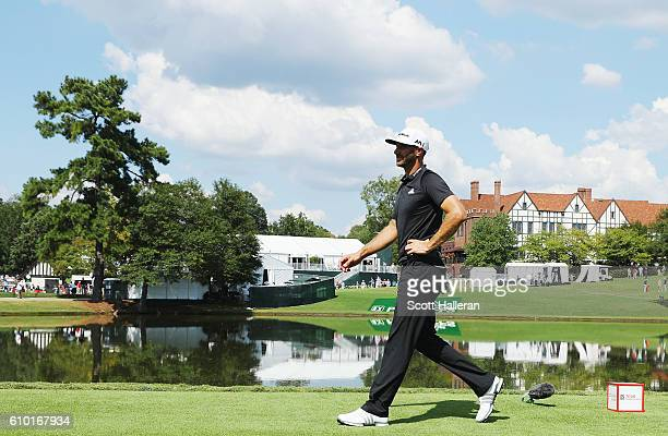 Dustin Johnson walks on the 16th hole during the third round of the TOUR Championship at East Lake Golf Club on September 24, 2016 in Atlanta,...