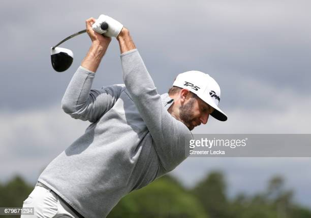 Dustin Johnson warms up on the driving range prior to round three of the Wells Fargo Championship at Eagle Point Golf Club on May 6 2017 in...