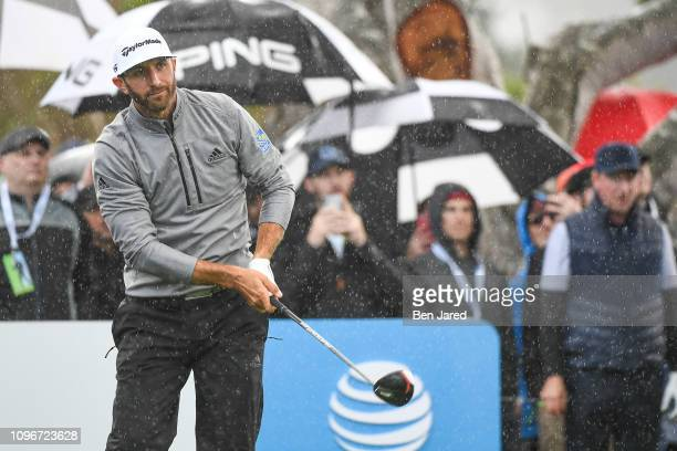 Dustin Johnson watches his shot on the thirteenth hole tee box during the third round of the ATT Pebble Beach ProAm at Pebble Beach Golf Links on...