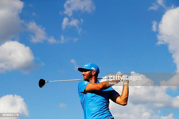 Dustin Johnson watches his tee shot on the 16th hole during the second round of the TOUR Championship at East Lake Golf Club on September 23 2016 in...