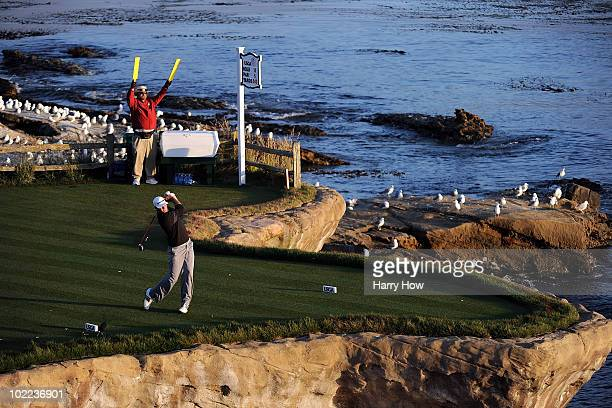 Dustin Johnson watches his tee shot on the 18th hole during the third round of the 110th US Open at Pebble Beach Golf Links on June 19 2010 in Pebble...