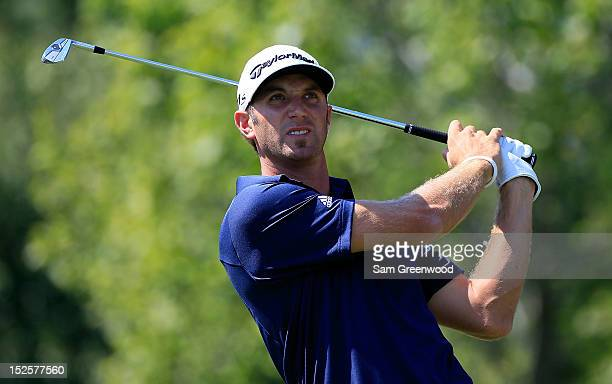 Dustin Johnson watches his tee shot on the second hole during the third round of the TOUR Championship by CocaCola at East Lake Golf Club on...