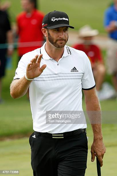 Dustin Johnson waves to the gallery after making a birdie putt on the second hole during Round Two of the ATT Byron Nelson at the TPC Four Seasons...