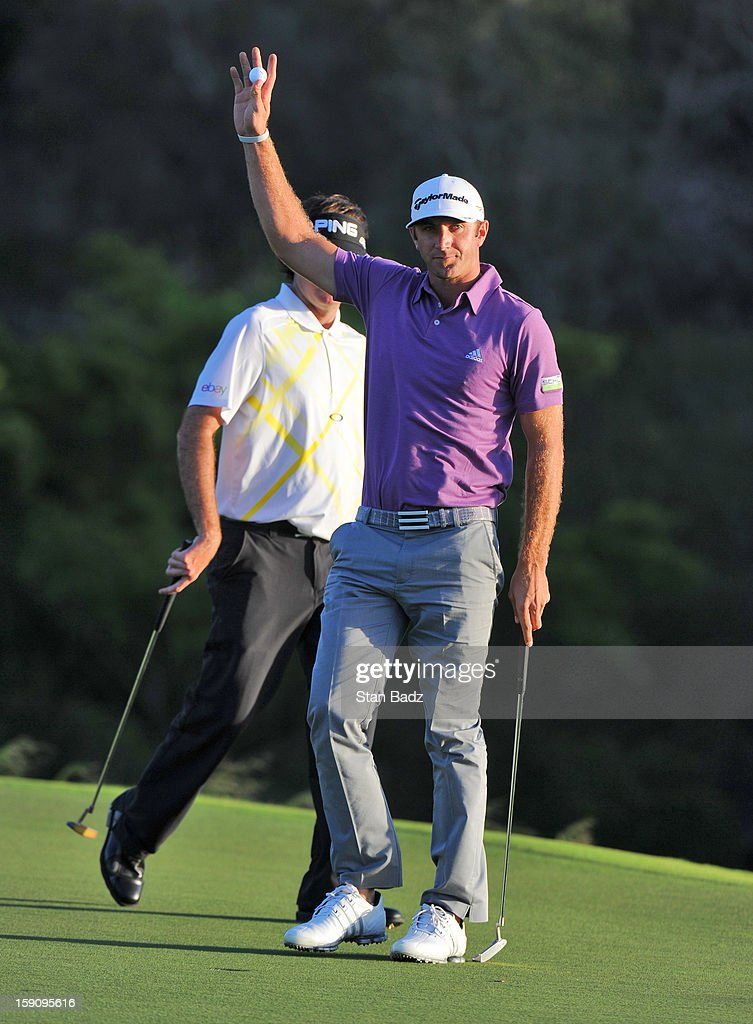 Dustin Johnson waves to the gallery on the 18th hole during the second round of the Hyundai Tournament of Champions at Plantation Course at Kapalua on January 7, 2013 in Kapalua, Maui, Hawaii.