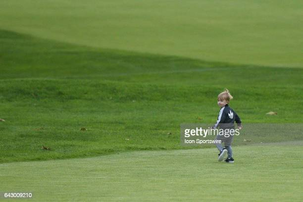 Dustin Johnson's son Tatum runs up the 18th green after the final round of the Genesis Open golf tournament at the Riviera Country Club on February...