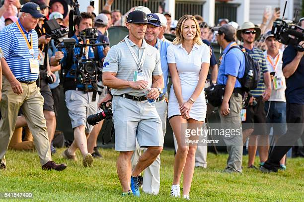 Dustin Johnson's trainer Joey Diovisalvi agent David Winkle and fiancee Paulina Gretzky walk to the trophy ceremony following Johnson's three stroke...