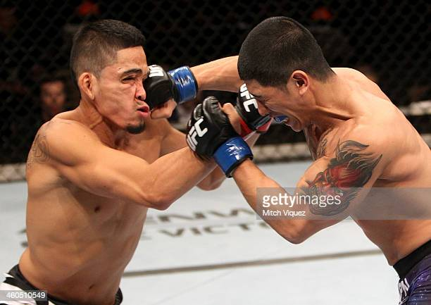Dustin Kimura lands a punch on Jon Delos Reyes in their bantamweight bout during the UFC Fight Night event at the Marina Bay Sands Resort on January...
