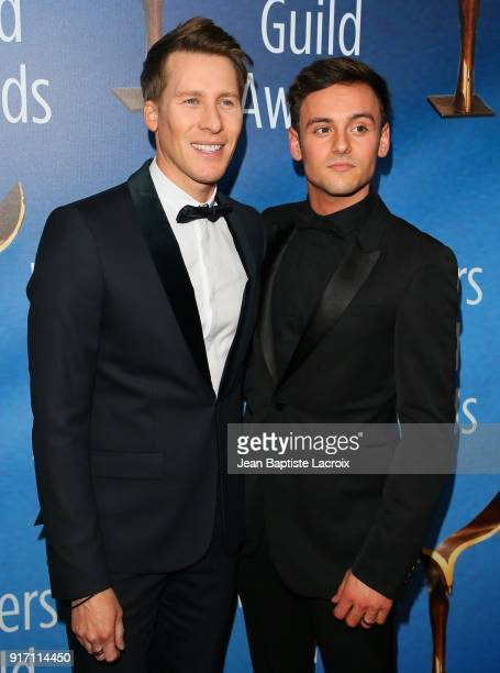 Dustin Lance Black and Tom Daley attend the 2018 Writers Guild Awards LA Ceremony on February 11 2018 in Beverly Hills California