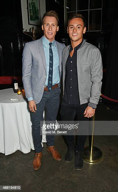 Dustin Lance Black and Tom Daley attend the 'Photograph 51' press night after party at the The National Cafe on September 14 2015 in London England