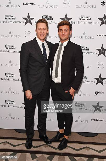 Dustin Lance Black and Tom Daley pose at The London Evening Standard British Film Awards at Claridge's Hotel on December 8 2016 in London England