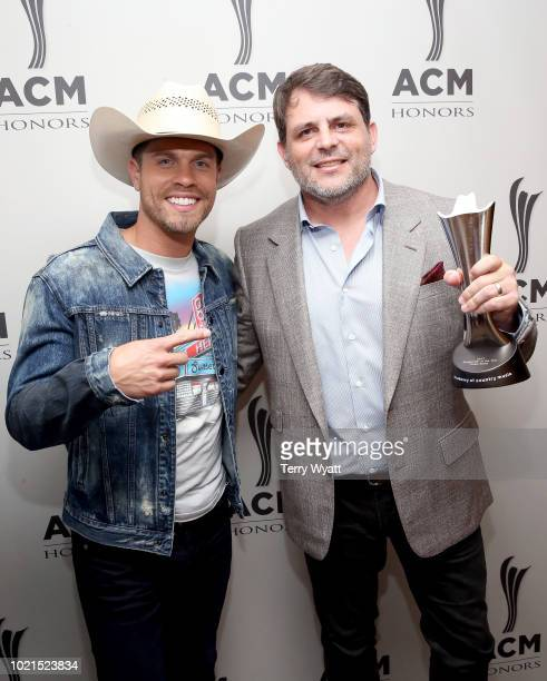 Dustin Lynch and honoree Rhett Akins take photos during the 12th Annual ACM Honors at Ryman Auditorium on August 22 2018 in Nashville Tennessee