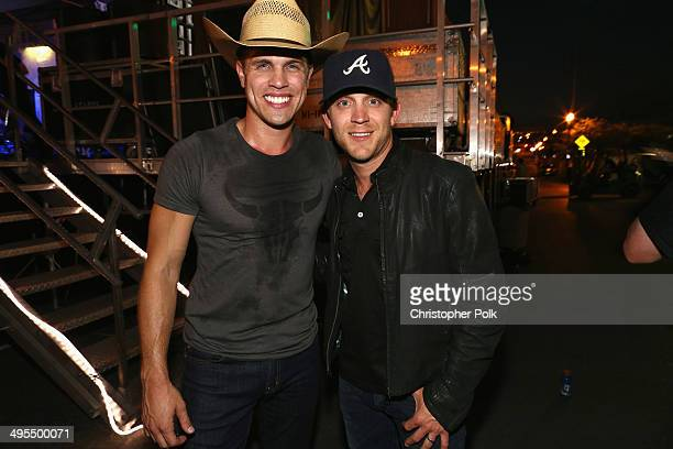 Dustin Lynch and Justin Moore pose backstage during Rodney Atkins 4th Annual Music City Gives Back on June 3 2014 in Nashville Tennessee
