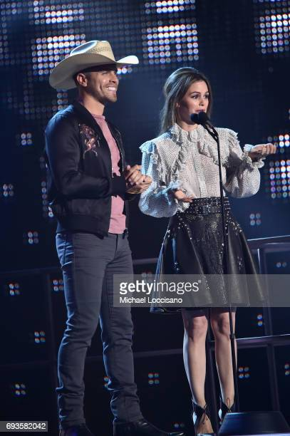 Dustin Lynch and Rachel Bilson present award onstage during the 2017 CMT Music Awards at the Music City Center on June 6 2017 in Nashville Tennessee