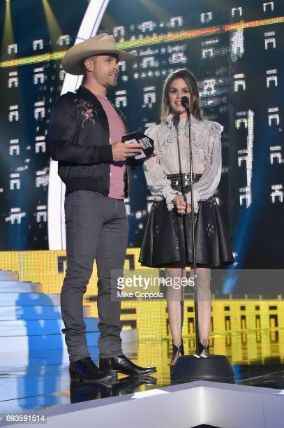 Dustin Lynch and Rachel Bilson speak onstage during the 2017 CMT Music Awards at the Music City Center on June 6 2017 in Nashville Tennessee