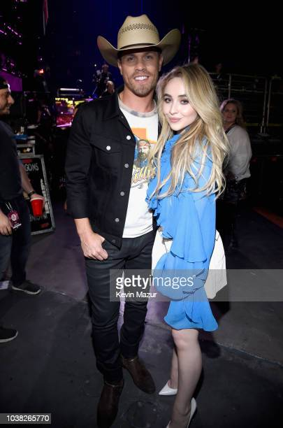 Dustin Lynch and Sabrina Carpenter attend the 2018 iHeartRadio Music Festival at TMobile Arena on September 22 2018 in Las Vegas Nevada