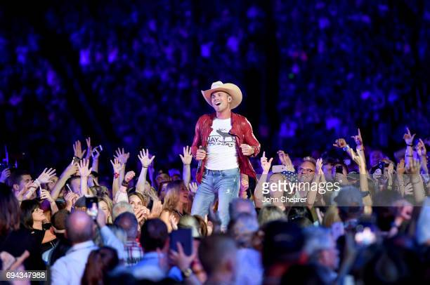 Dustin Lynch performs on stage for day 2 of the 2017 CMA Music Festival on June 9 2017 in Nashville Tennessee