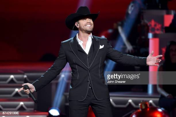 Dustin Lynch performs onstage for CMA 2017 Country Christmas at The Grand Ole Opry on November 14 2017 in Nashville Tennessee
