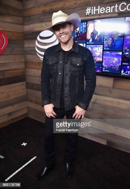 Dustin Lynch poses backstage at the 2018 iHeartCountry Festival By ATT at The Frank Erwin Center on May 5 2018 in Austin Texas