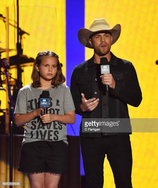 Dustin Lynch speaks onstage about St Jude's Children's Hospital during the 2018 iHeartCountry Festival By ATT at The Frank Erwin Center on May 5 2018...