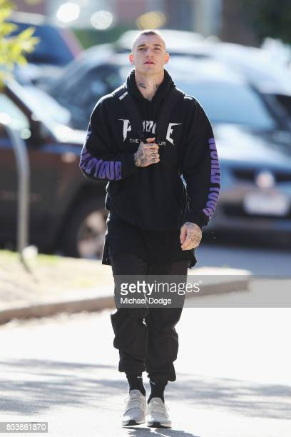 Dustin Martin a winner of the Brownlow medal last night arrives ahead of the Richmond Tigers AFL training session at Punt Road Oval on September 26...