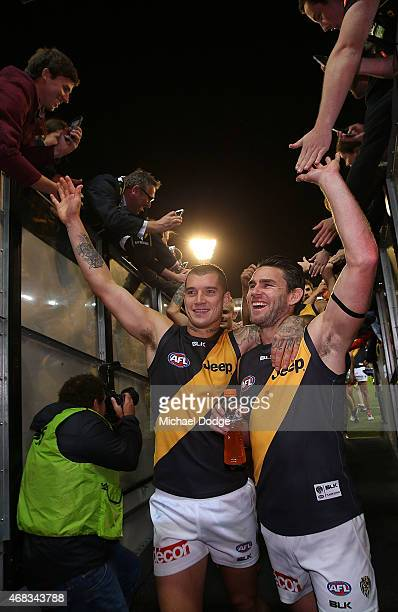 Dustin Martin and Chris Newman of the Tigers celebrate the win during the round one AFL match between the Carlton Blues and the Richmond Tigers at...