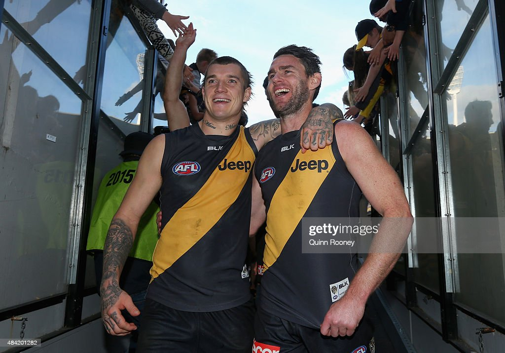 Dustin Martin and Chris Newman of the Tigers celebrate winning the round 20 AFL match between the Richmond Tigers and the Gold Coast Suns at Melbourne Cricket Ground on August 16, 2015 in Melbourne, Australia.