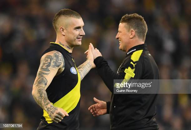 Dustin Martin and Tigers head coach Damien Hardwick shake hands before the start of the AFL Preliminary Final match between the Richmond Tigers and...