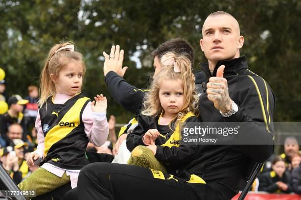 Dustin Martin and Trent Cotchin of the Richmond Tigers attend the 2019 AFL Grand Final Parade on September 27, 2019 in Melbourne, Australia.