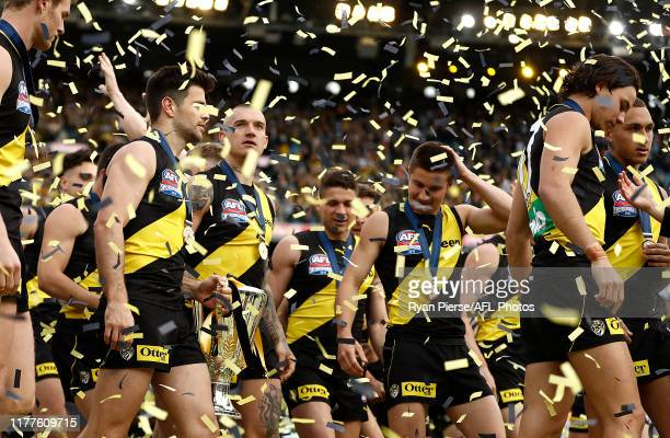 Dustin Martin and Trent Cotchin of the Tigers celebrate with the Premiership Cup during the 2019 AFL Grand Final match between the Richmond Tigers...