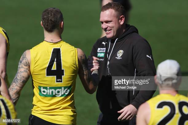 Dustin Martin is congratulated by assistant coach Justin Leppitsch after winning the Brownlow medal last night ahead of the Richmond Tigers AFL...