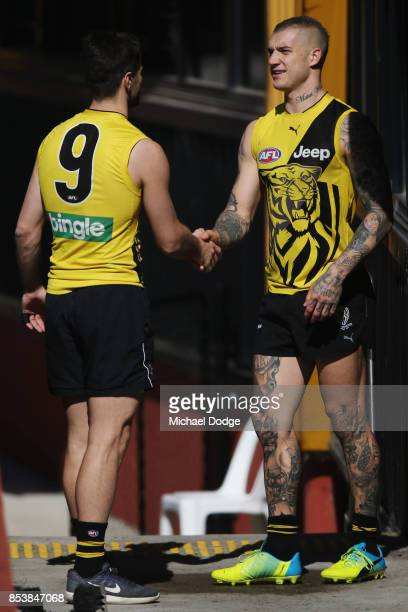 Dustin Martin is congratulated by Trent Cotchin after winning the Brownlow medal last night ahead of the Richmond Tigers AFL training session at Punt...