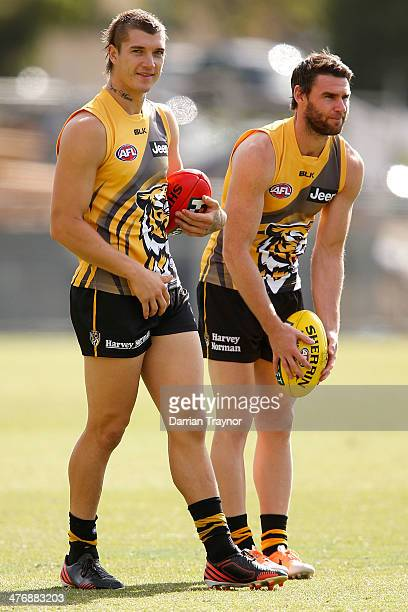 Dustin Martin looks on as Chris Newman lines up to kick the ball during a Richmond Tigers AFL training session at ME Bank Centre on March 6 2014 in...