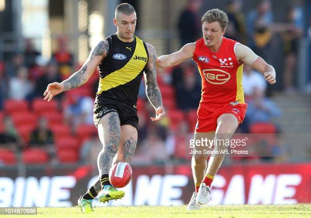 Dustin Martin of Richmond kicks the ball during the round 21 AFL match between the Gold Coast Suns and the Richmond Tigers at Metricon Stadium on...
